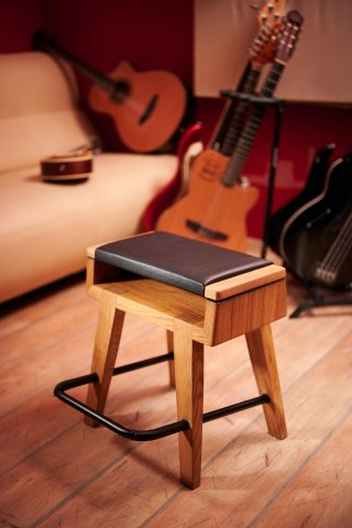 Harmony oak frame guitar stool stand footrest combo on display in studio with guitars in background