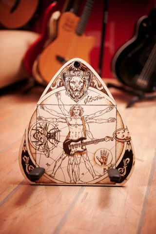 God's Pick custom made guitar floor stand with motive of Vitruvian using pyrography