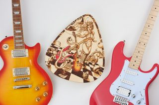 Guitar God Ms. Queen wall art with 2 guitars